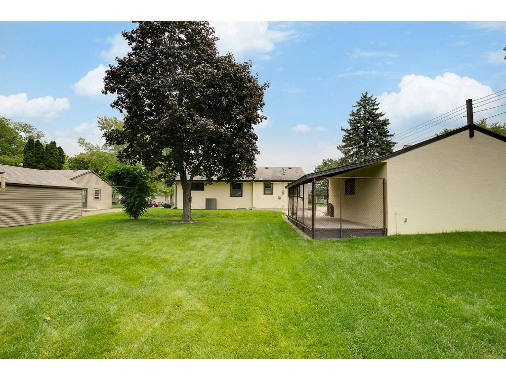 Photo from the back of the lot showing the gorgeous lot and the back of the home.