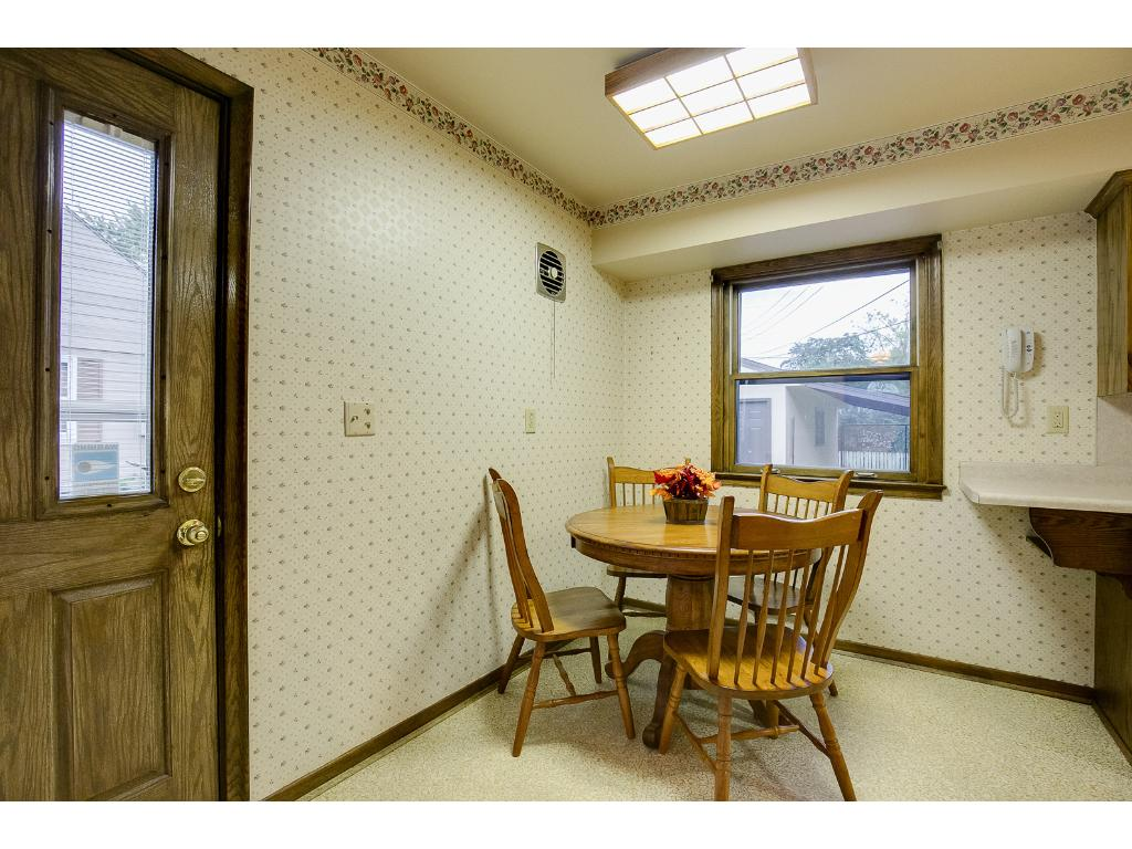 Side entrance conveniently walks into the kitchen/dining room.