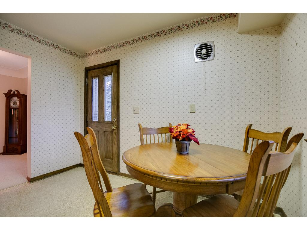 Side entrance showing the dining room space that is big enough for a nice sized dining table.