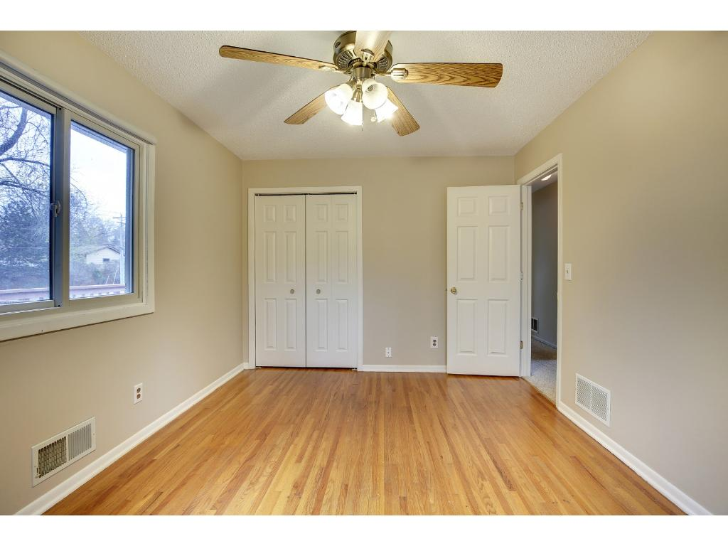 Each bedroom features wood floors, good size closets and ceiling fans.