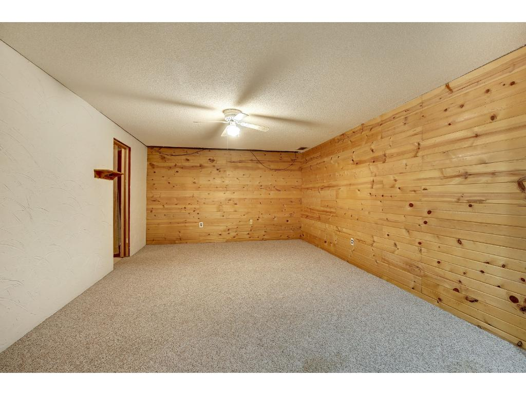 Knotty Pine warms 2 of the walls.