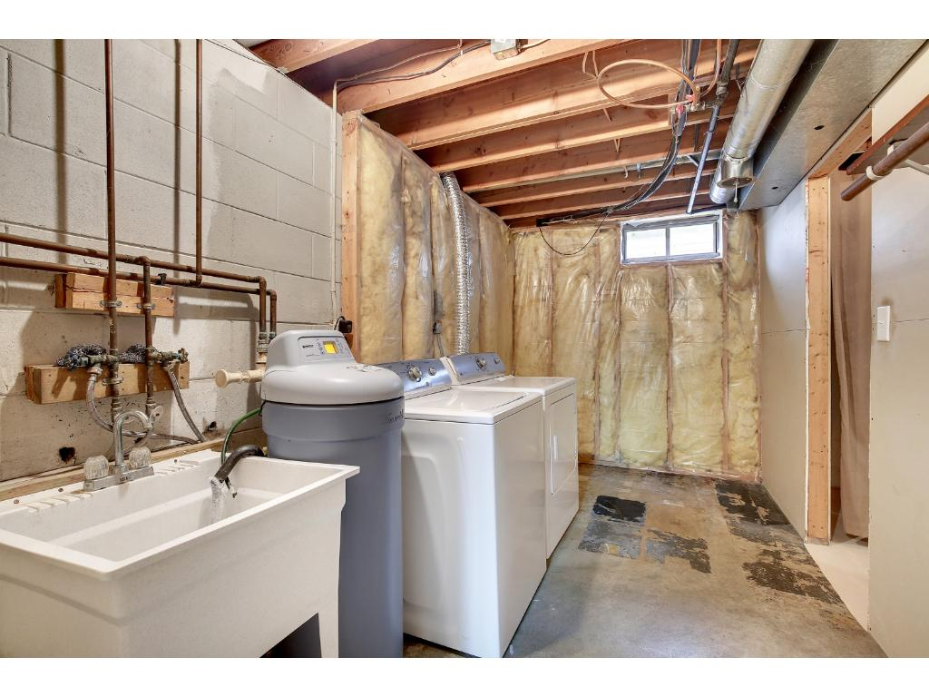 Close by is a toilet room, laundry and utilities.