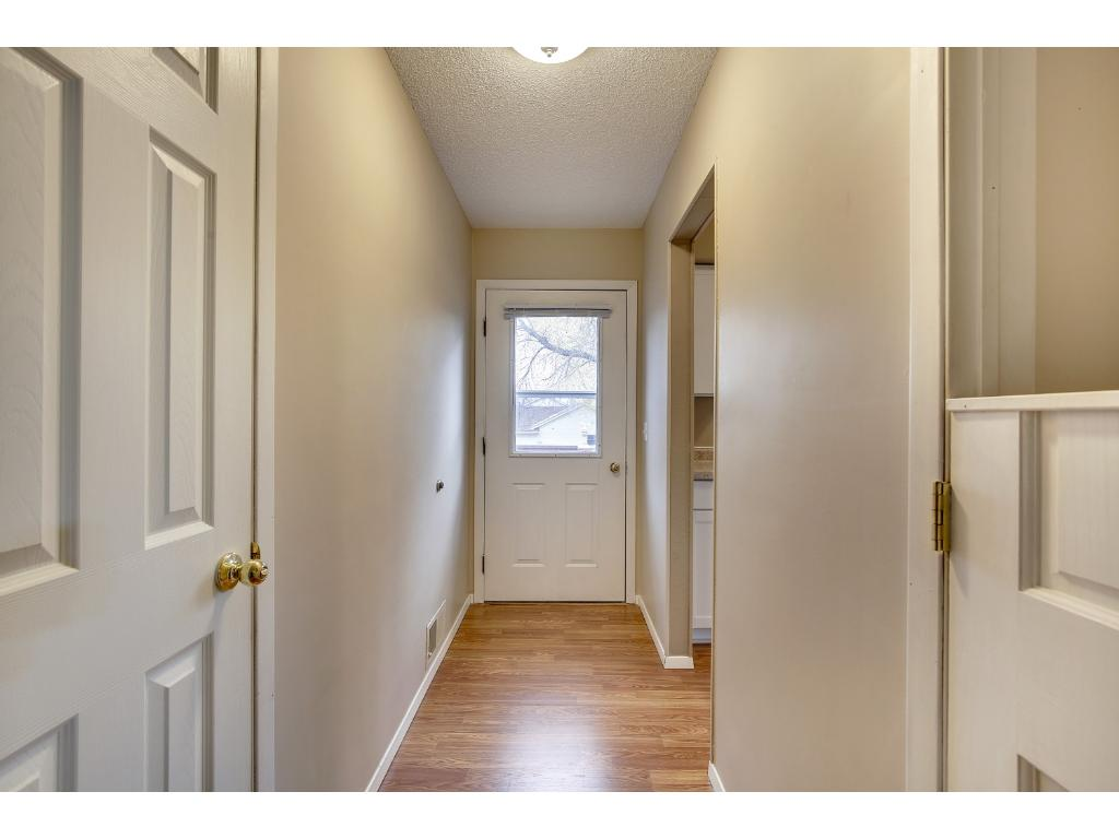 Beautiful wood flooring welcomes you at the front door.  A closet is right here for guests.