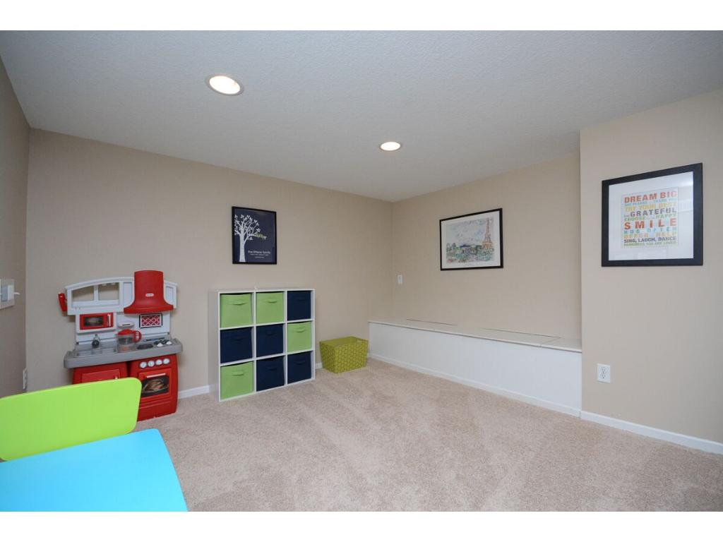 A built-in bench for toys and storage was added when remodeled.  There is a lot of great organization to this home!