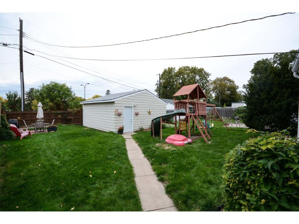 Two car detached garage and a great fenced-in backyard!  Playset can stay with the home or can be removed.  Fence was put in by Dakota Fence.