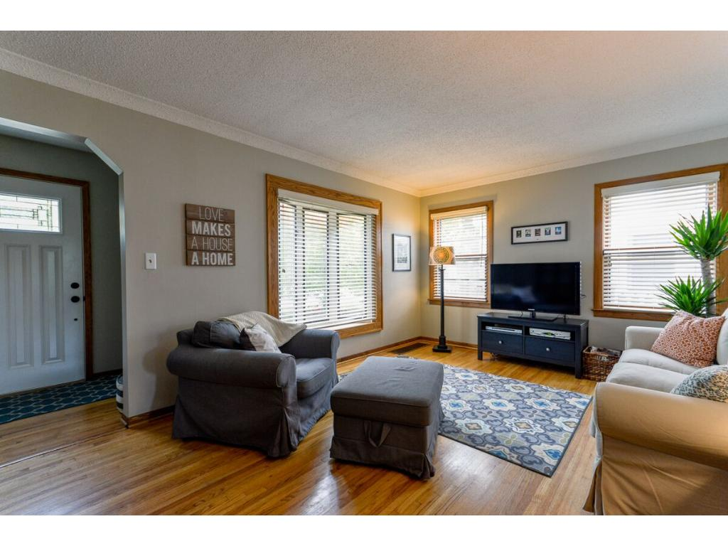 Entryway has a front hall closet and a newer front door with great lighting in the living room with the windows!