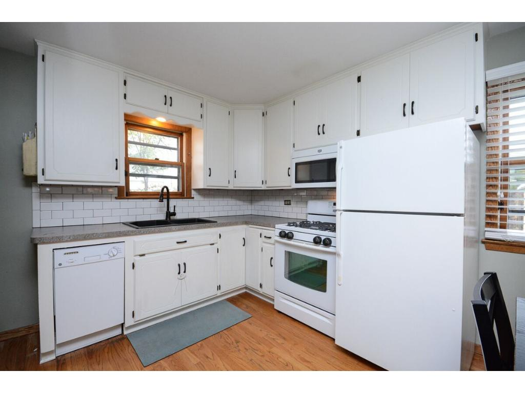 Updated kitchen and eat-in kitchen area.  There is a side entrance to the home through the kitchen.