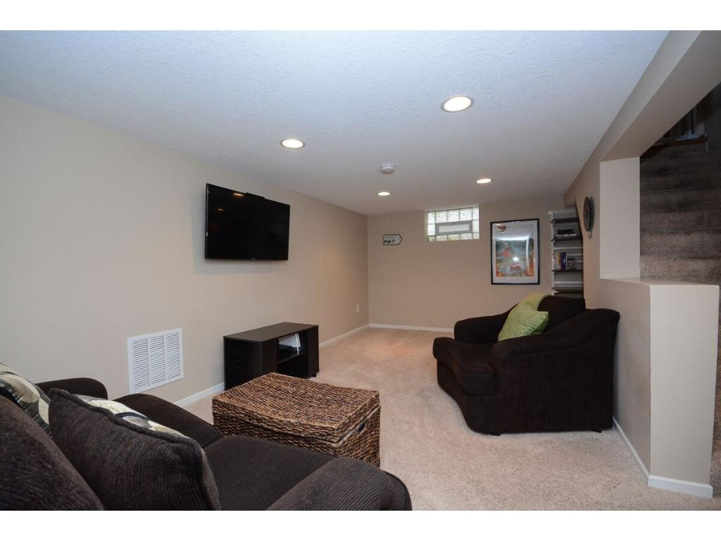 Updated family room in the lower level.  Included with the sale is an Elfa Desk making a home office nook.