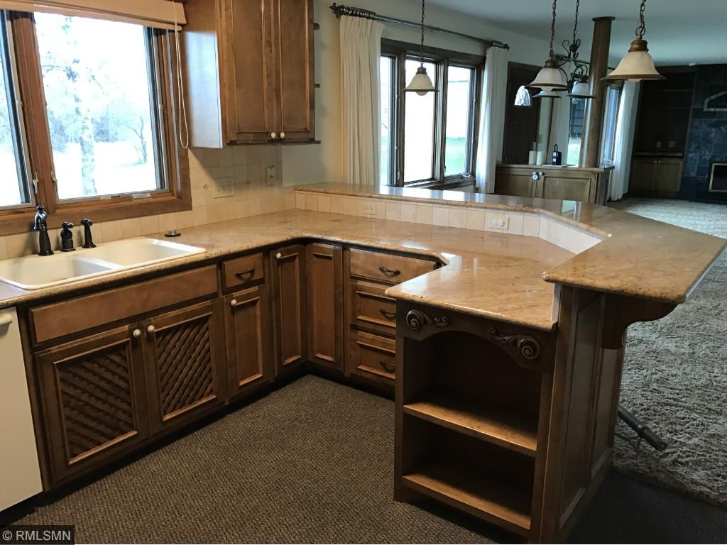 Granite Counters with Breakfast Area.