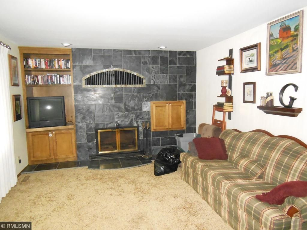 Large Living Room/Family Room with Fireplace and lots of Marble.