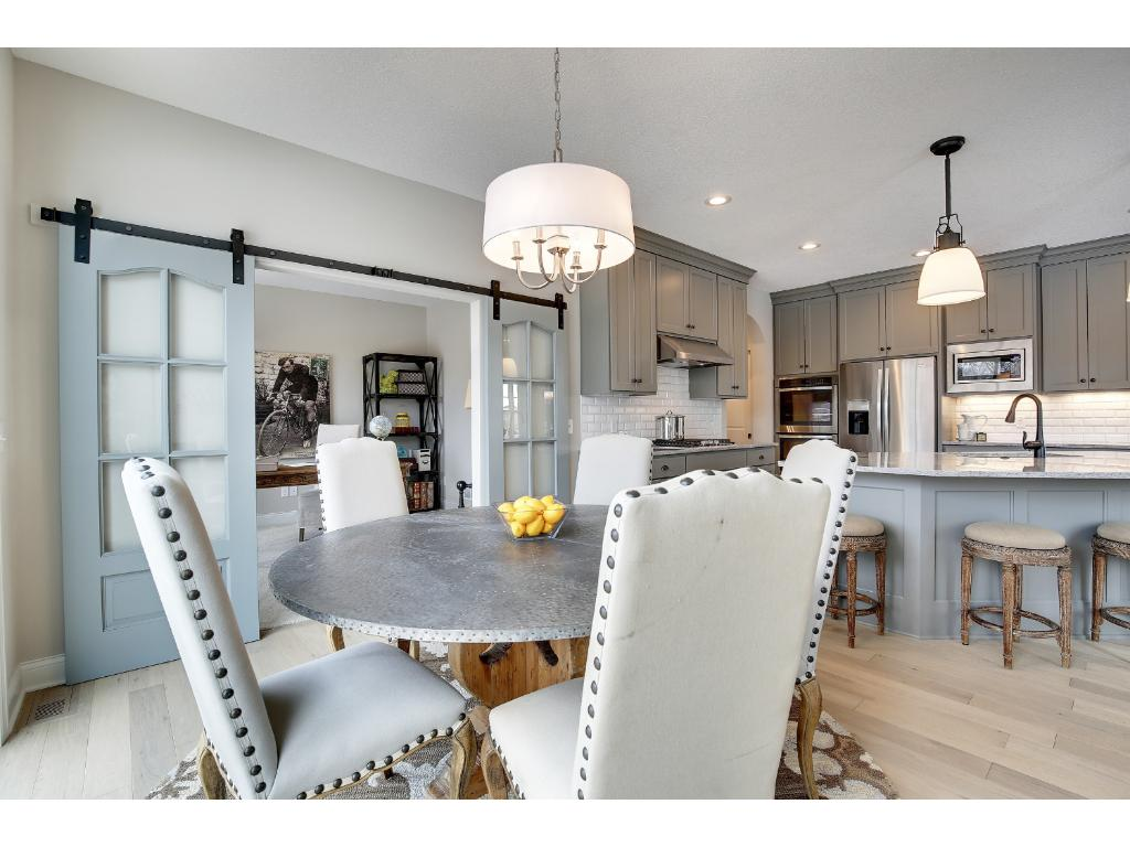 The informal dining space in the kitchen looks out onto the large deck and beautiful lot.