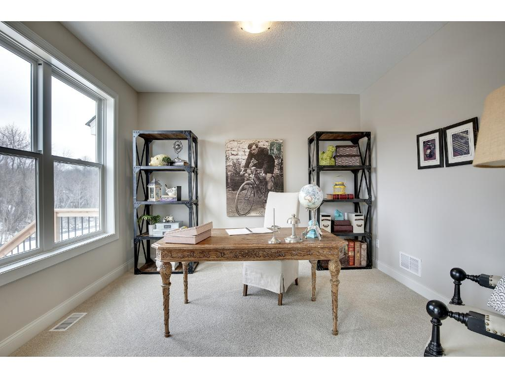 This is a flex space off of the kitchen that would make a great office or playroom!