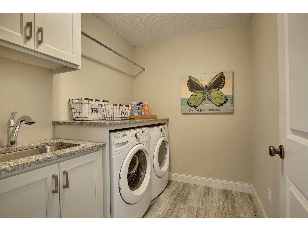 Upper level laundry room with plenty of storage.