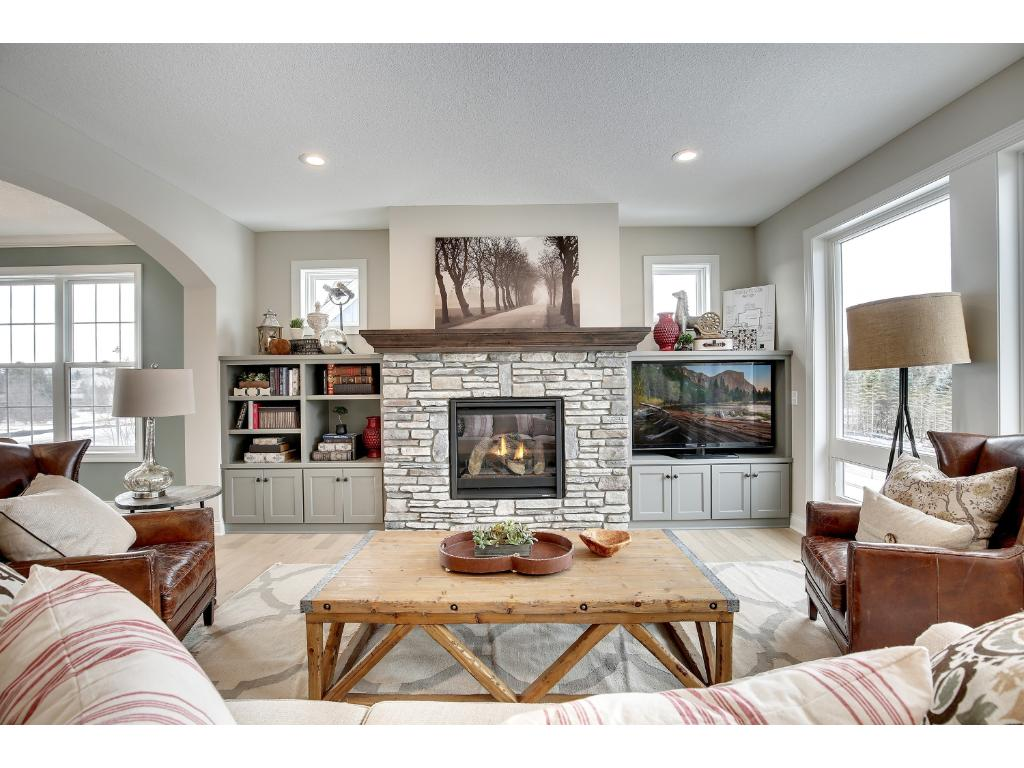 Another view of the main level family room with gas fireplace and built-ins.
