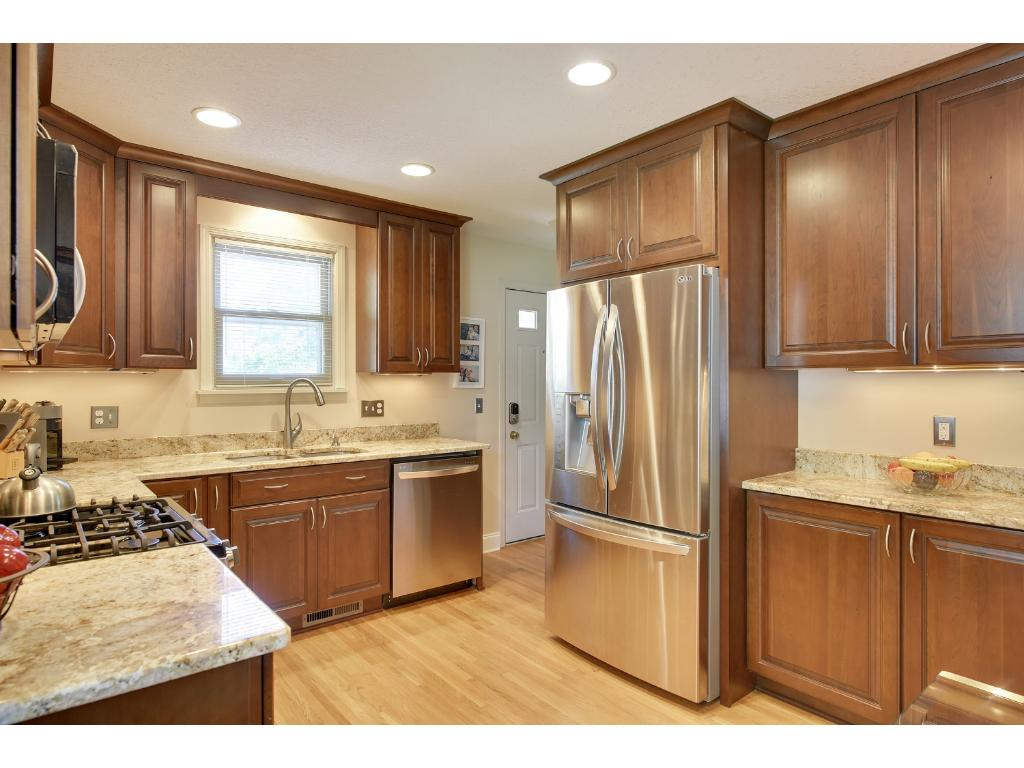 Upgraded granite species is absolutely BEAUTIFUL!!   Cabinetry adorned with crown molding.