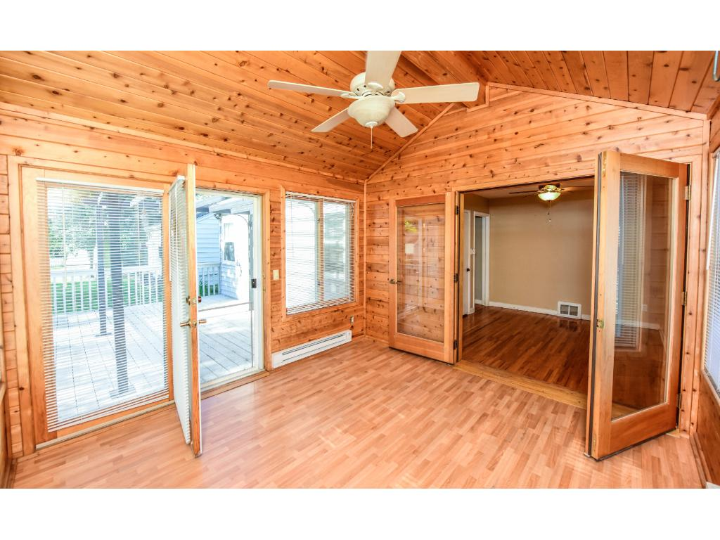 Four season Porch with French doors and patio off to the side