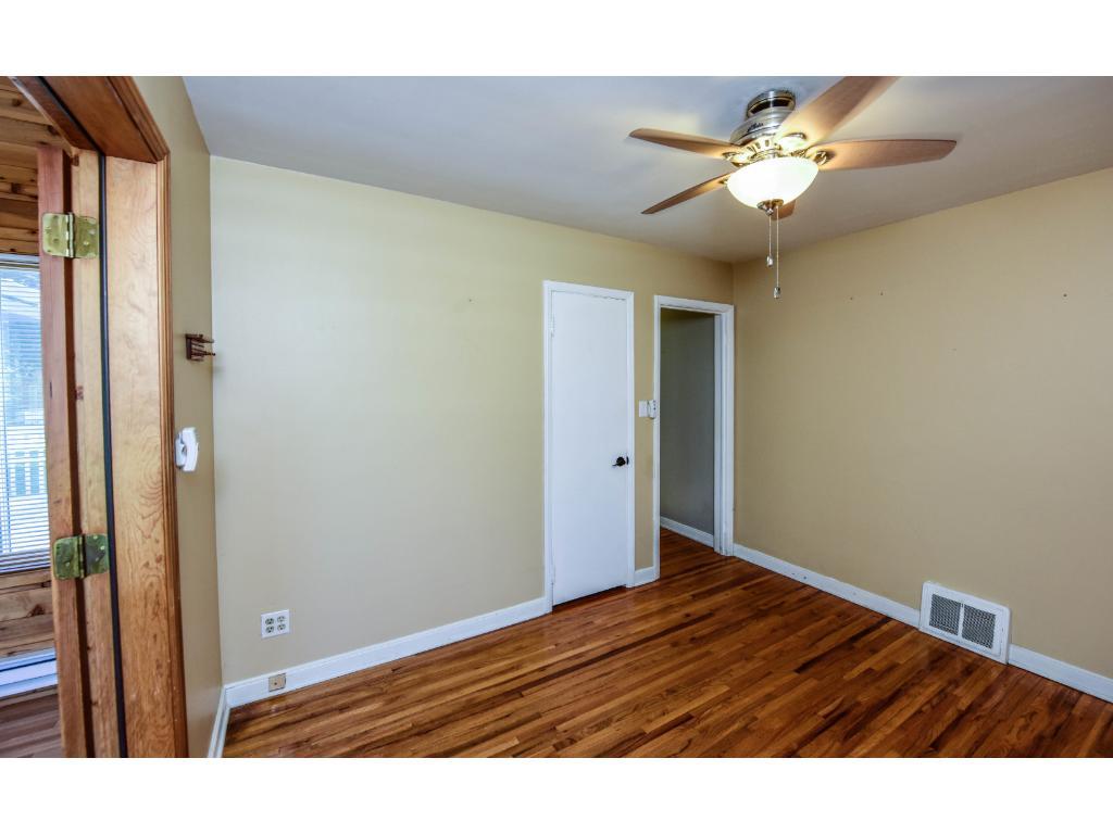 Main floor bedroom, original hardwood floors