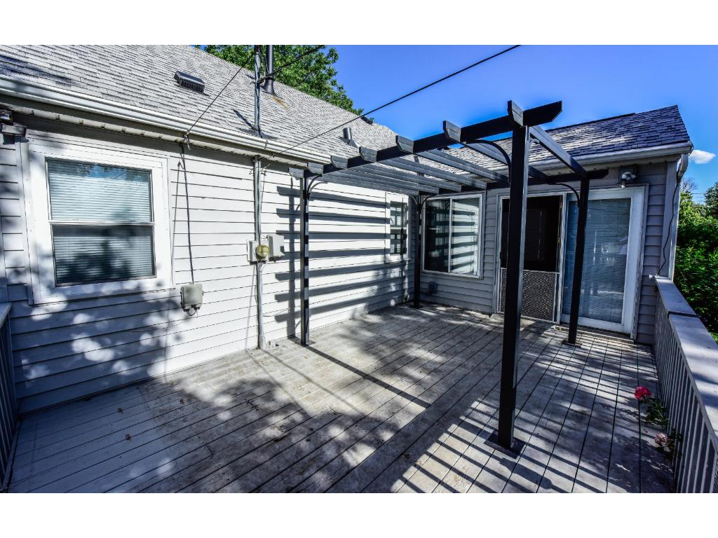 Beautiful deck off four season porch with pergola