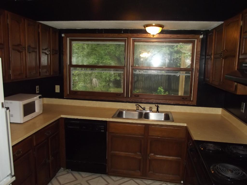 lots of cabinet and counter space with large double windows to the back yard