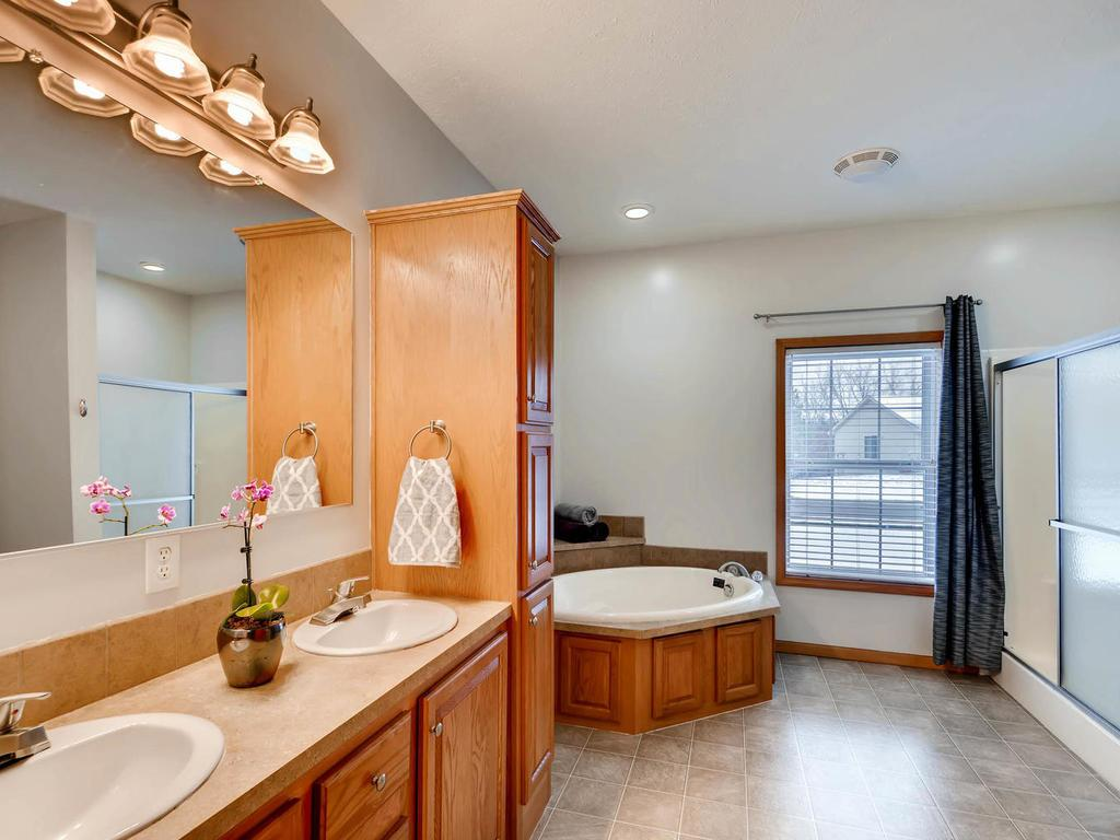 Massive, private master bathroom with separate soaking tub and shower