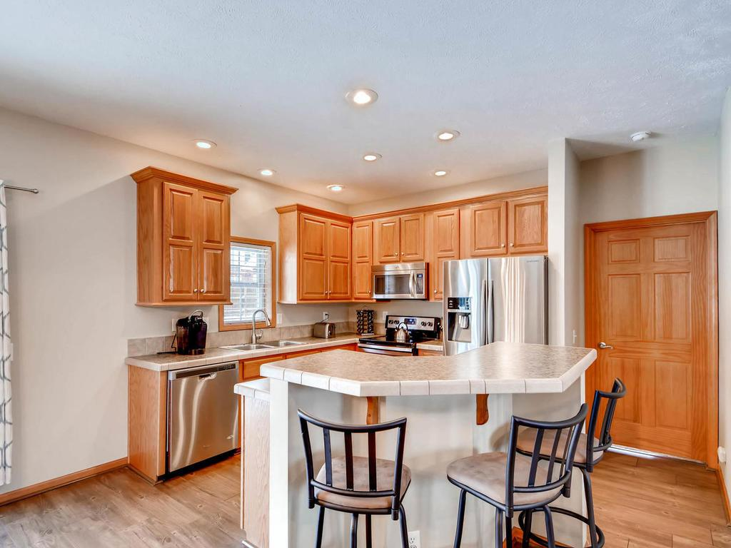 Kitchen has stainless appliances, lots of cabinet space and a 2-tier island