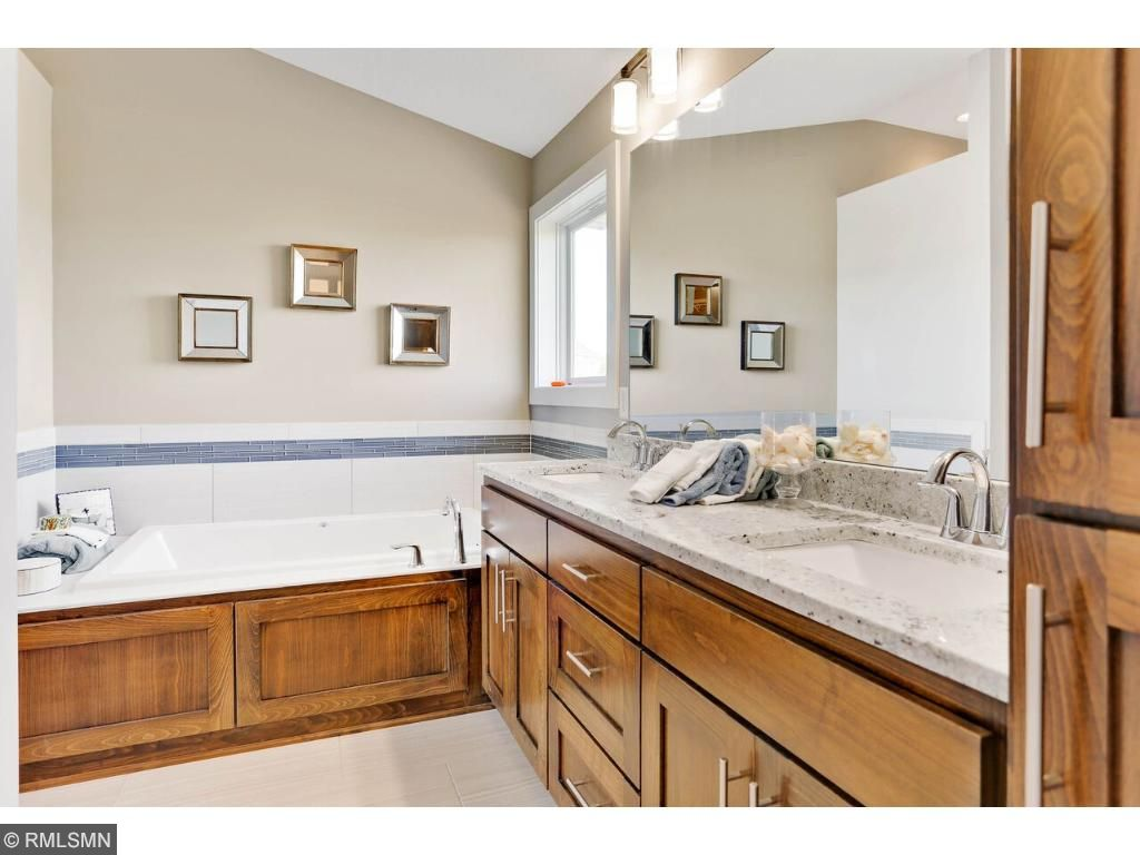 Spa-like bath with his n her sinks, separate tub and shower with tile, plus private commode.