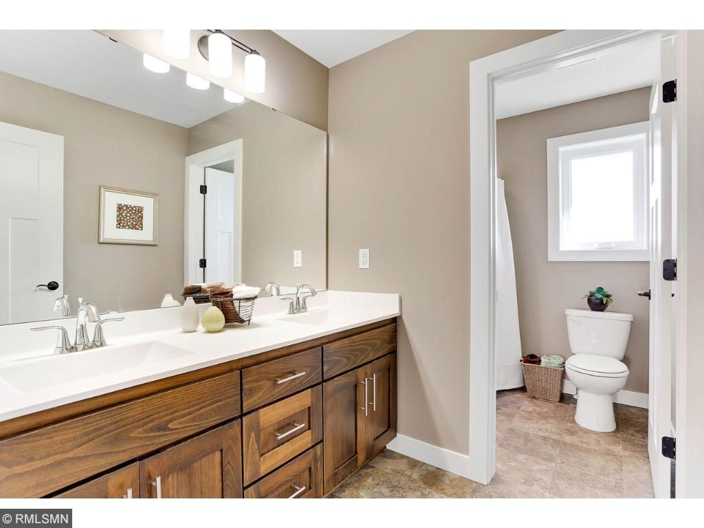 Smart!  Kids bath with separate stool and shower area and double vanity.