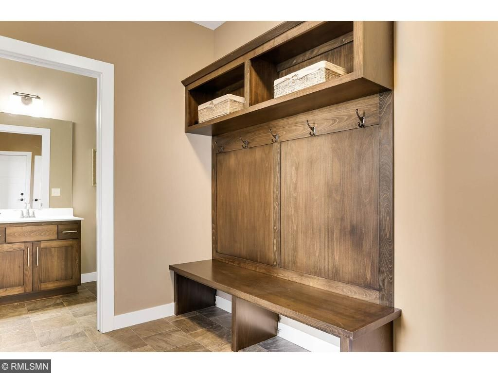 Stay Organized with bench & cubbies in the large mudroom with convenient half bath off the garage entry.