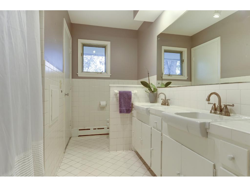 Main level Full Bath with double sinks.