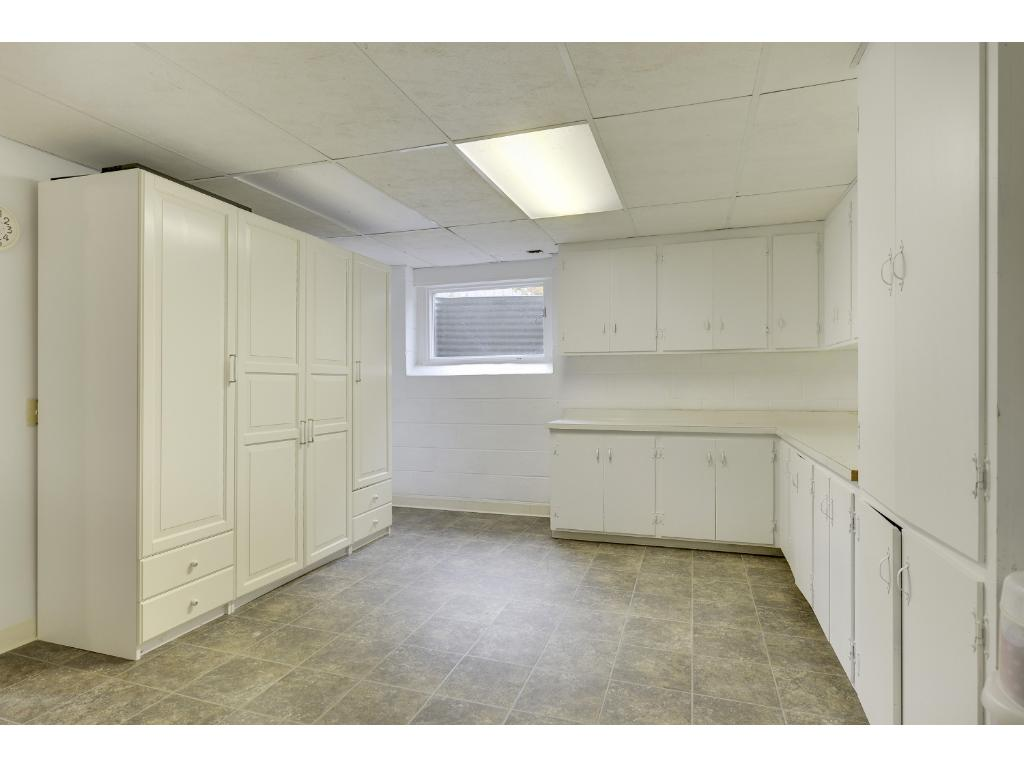 Lower level Utility Room offers tons of storage.