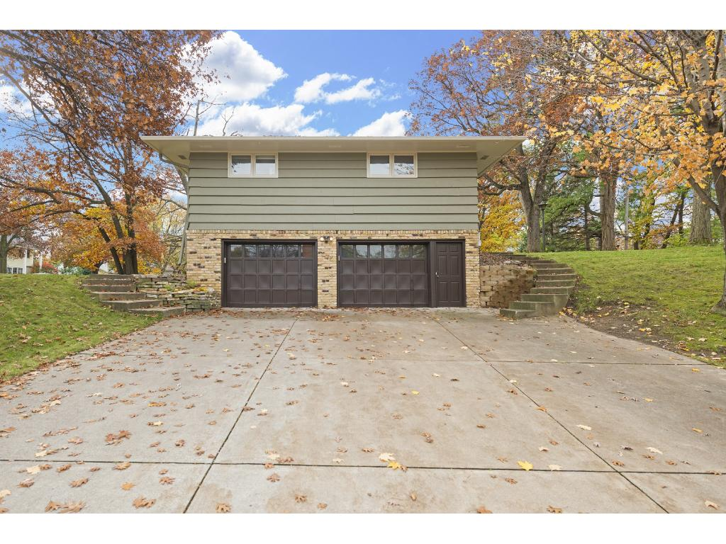 Spacious, two-car tuck under Garage with extra-wide concrete driveway.