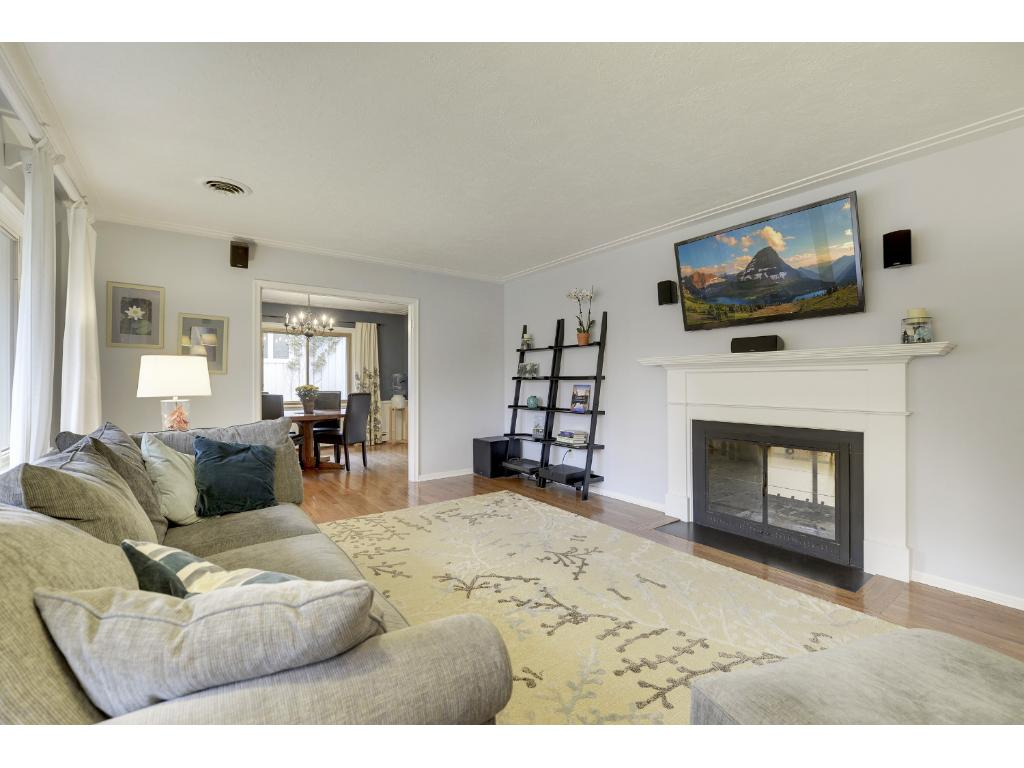 Living Room and Family Room share a see-through, wood-burning Fireplace.