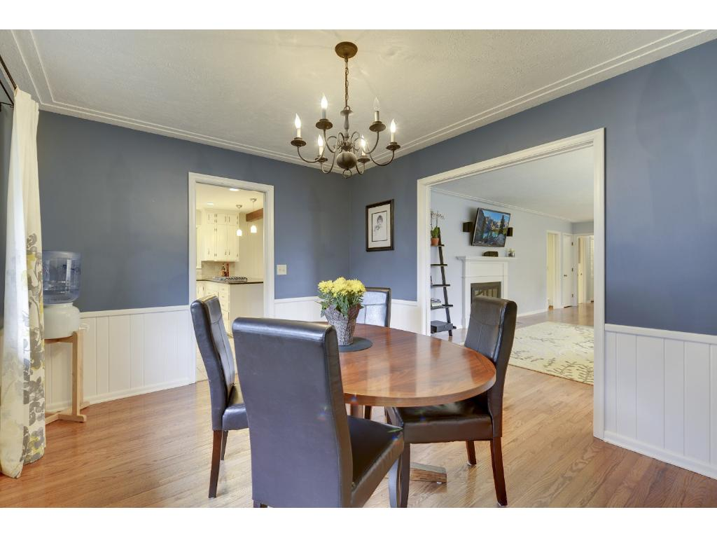 Dining Room with views of Kitchen (left) and Living Room (right).