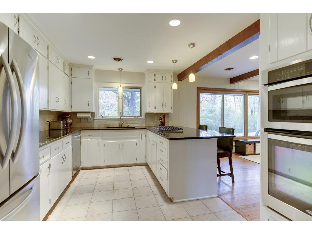 Updated Kitchen with granite counters, new stainless appliances.