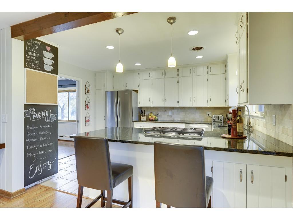 Fun, functional open Kitchen with custom lighting.