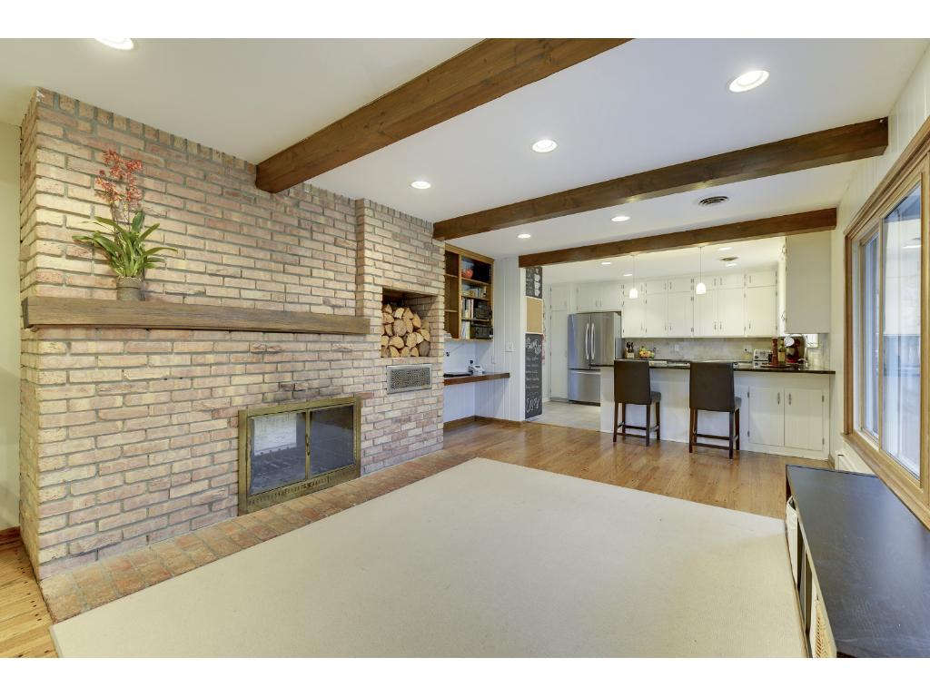 Family Room with Fireplace looking towards Kitchen.