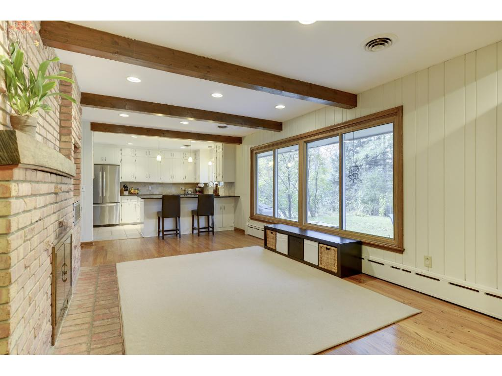 Family Room with exposed beam ceiling, great view of backyard.