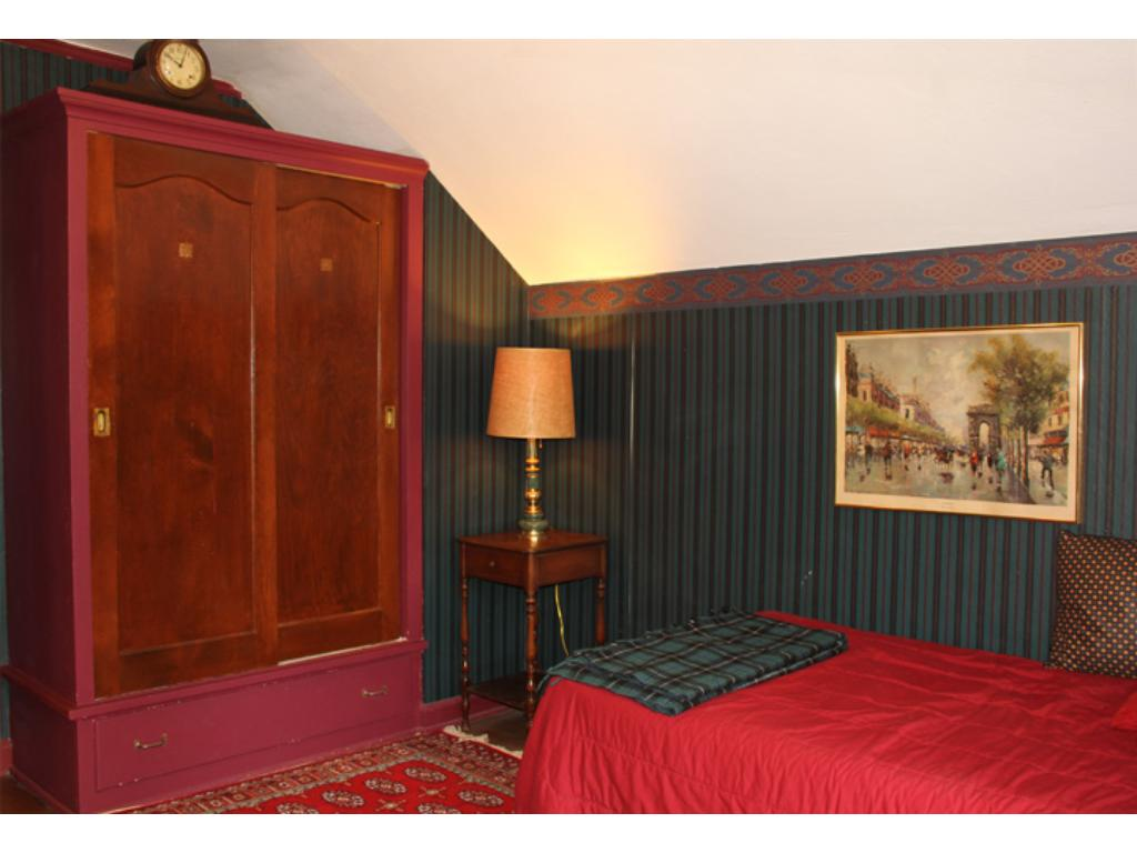 Second bedroom with built in armoire