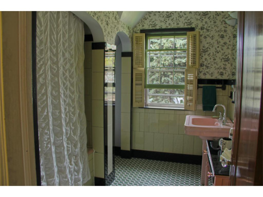 Original art deco tile in the full bath. Look for the palm tree tile on the bathtub!