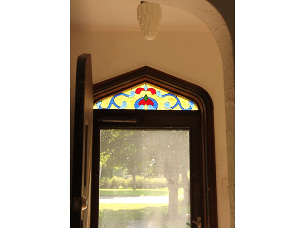 Interior of entry with original lighting and custom made stained glass.
