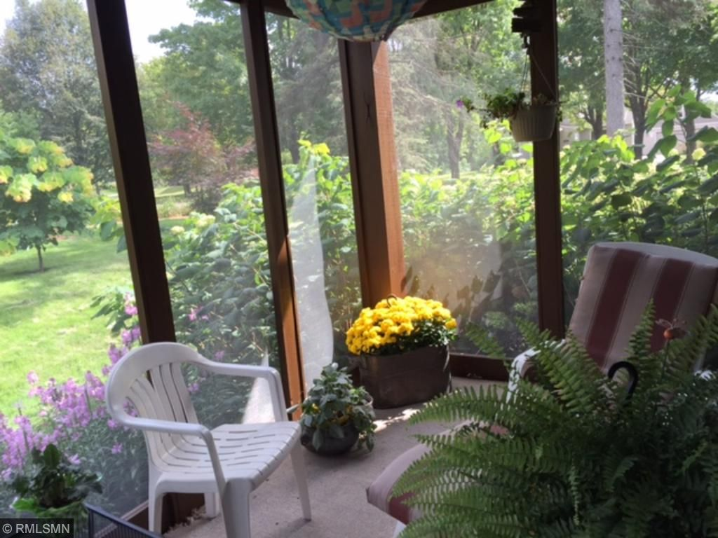 The three season porch is just off the formal dining room. Enjoy coffee out here in the mornings.