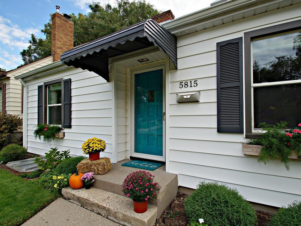 Adorable one and a half story with maintenance free siding!
