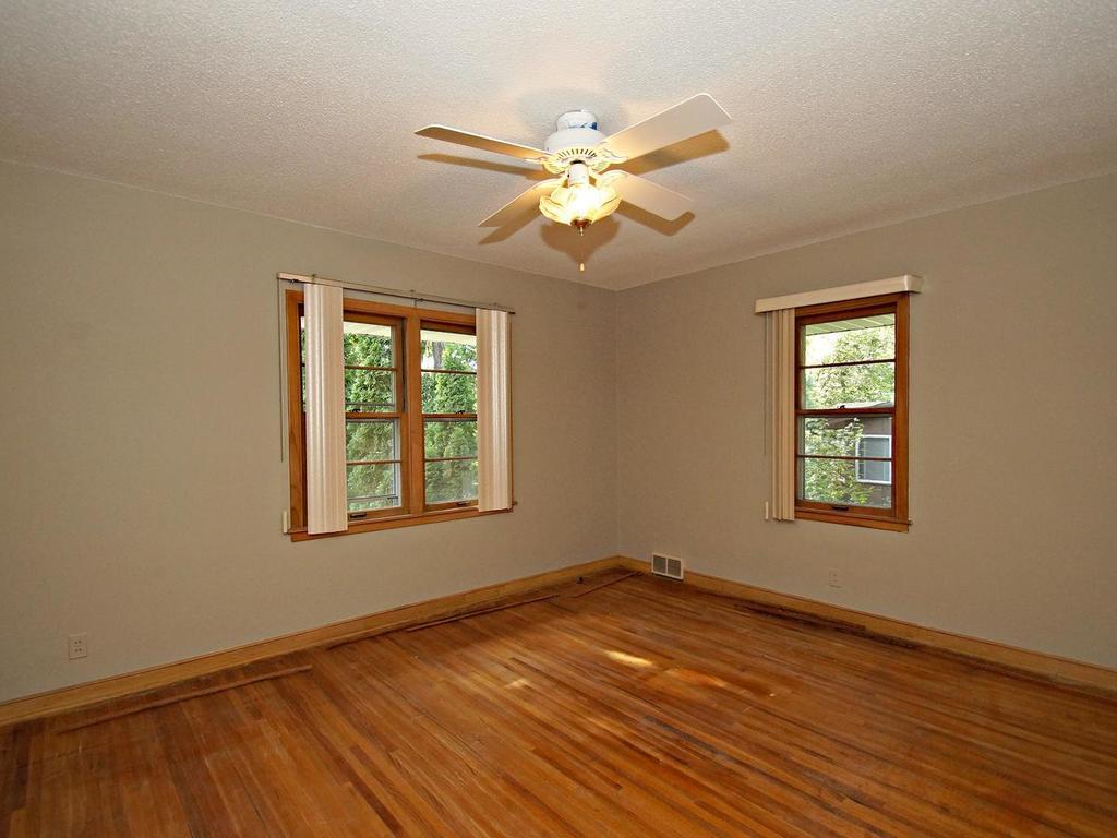 Hardwood floors in this bedroom space.
