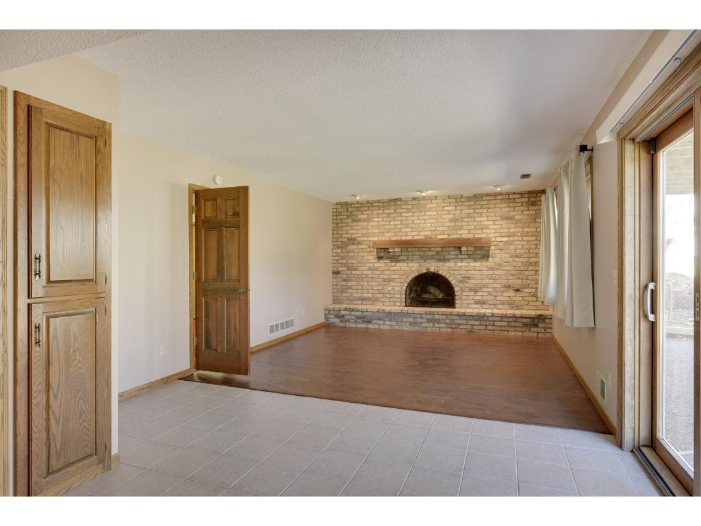 Lower Level Family Room Includes A Walkout and Wood Burning Fireplace
