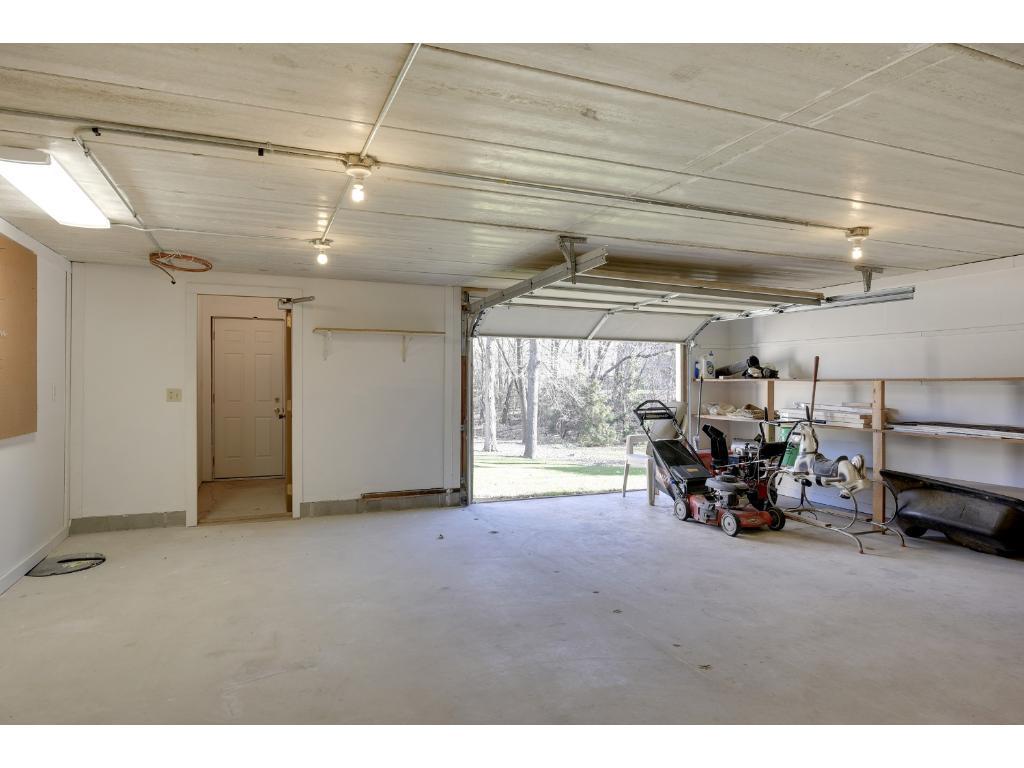 Lower Level Garage Includes An Overhead Garage Door