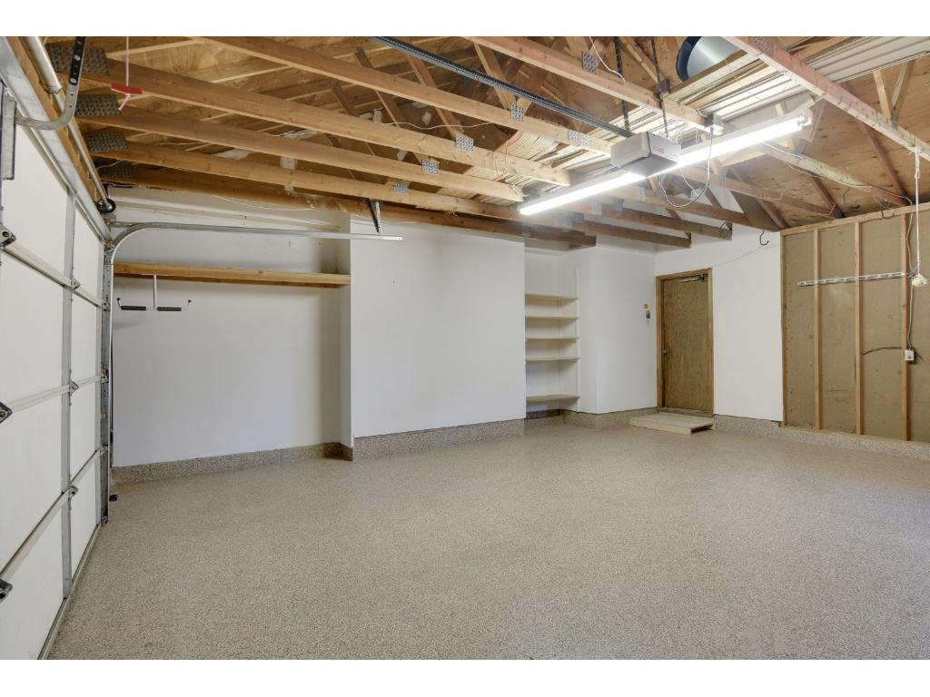Huge Two Car Garage With Coated Floors.