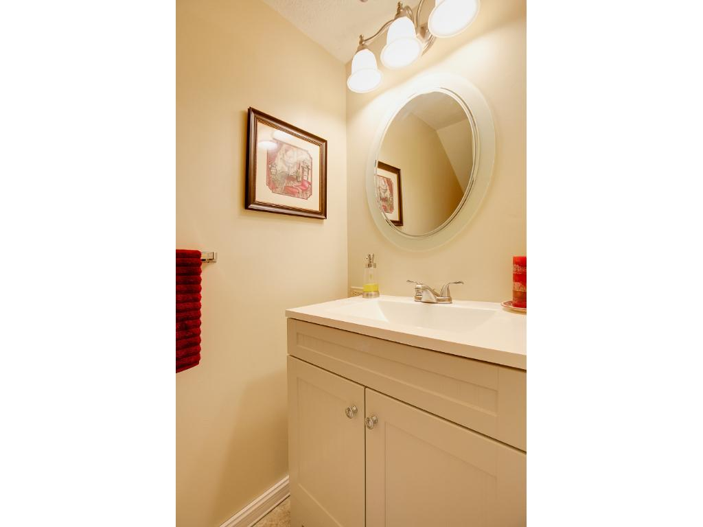 Main level half bath with brand new vanity.