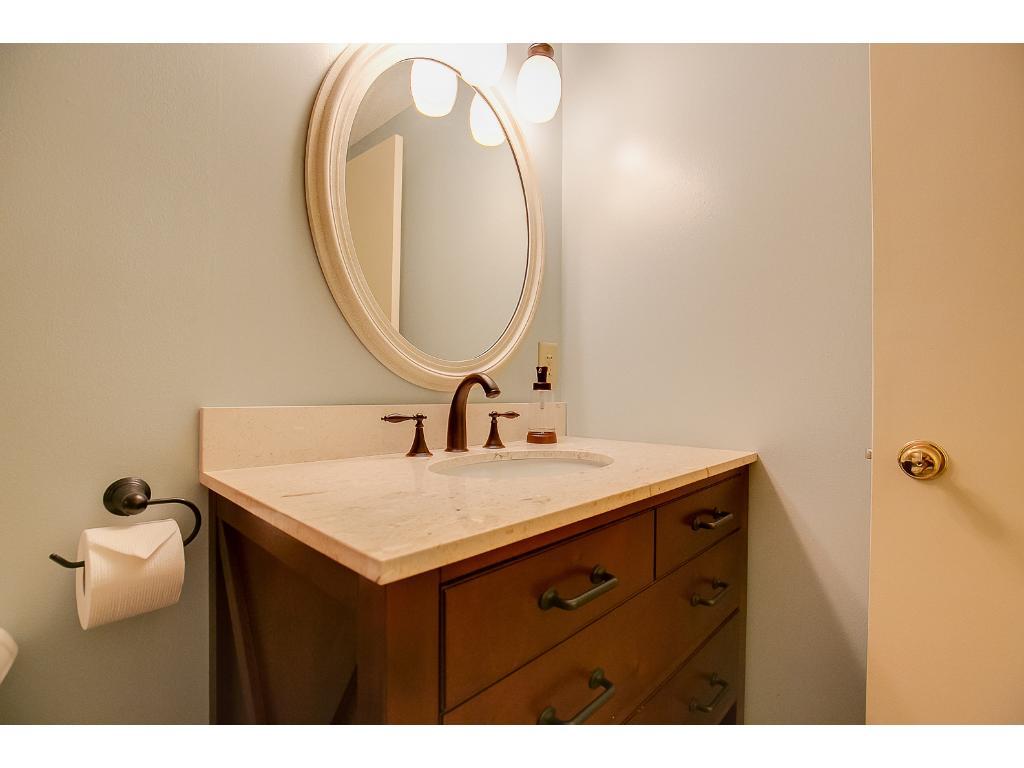 Full upper level bathroom with updated vanity.