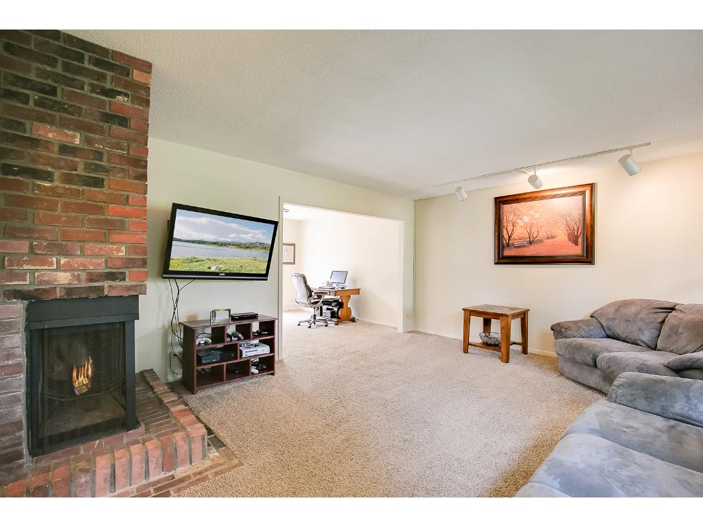 Large living room with lots of windows to let plenty of sunshine in.