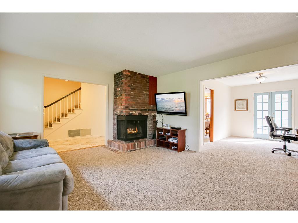 Stunning brick wood-burning fireplace in living room.